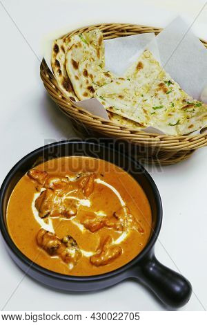 Butter Chicken Curry Or Masala With Garlic Naan, Indian Food Delicacy, Chicken Cooked In Rich Tomato