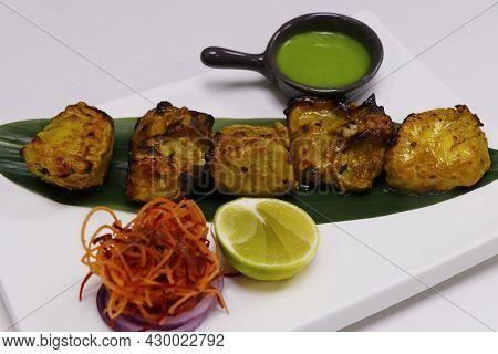 Tandoori Fish Tikka, Clay Oven Roasted Ajwain Flavored Fish Cubes, Coated With Gram Flour, Yoghurt A