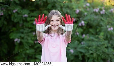Child Girl Show Hands Painted In Indonesia Flag Colors. Indonesian Patriotism Concept. Indonesian In