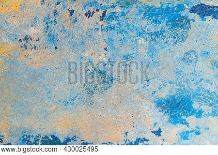 Old Blue Cracked Paint The Old Wall Background, Painted Concrete Wall. Abstract Background. Art Text