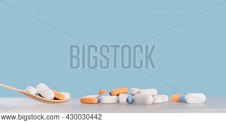 Background Of White Tablets Or Pills On Blue Table. Medicine And Pharmacy