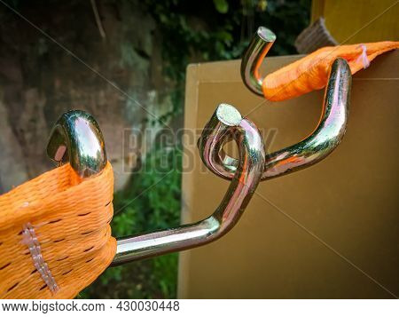 Detail View Of A U-profile Hook At An Orange Ratchet Strap For The Secure Fastening Of Loads