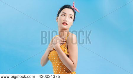 Slender Female Model In A Yellow Polka Dot Dress Goes On A Date