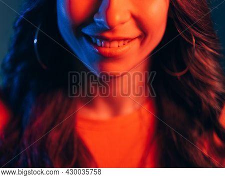 Neon Light Smile. Positive Emotion. Facial Expression. Dental Care. Unrecognizable Radiant Woman Fac