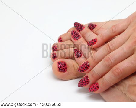 Womens Fingers Lie On The Foot, Varnish Is Visible On The Fingers And Toes, Shiny Aggressive Red Var