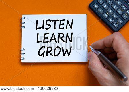 Listen, Learn, Grow Symbol. Businessman Writing Words Listen, Learn, Grow On White Note. Black Calcu
