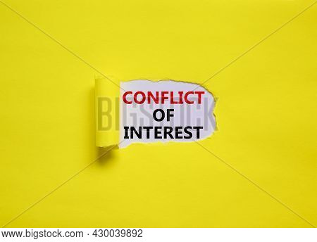 Conflict Of Interest Symbol. Words 'conflict Of Interest' Appearing Behind Torn Yellow Paper. Beauti