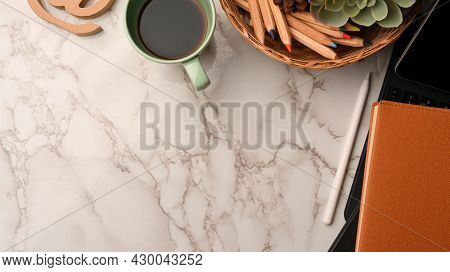 Copy Space On Marble Background Corner Border With Tablet, Stationery