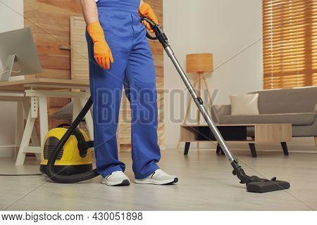 Janitor In Uniform Vacuuming Floor Indoors, Closeup