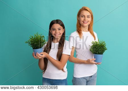 Fostering And Adoption. Happy Adopted Child And Mother Hold Houseplants. Foster Family. Fostering