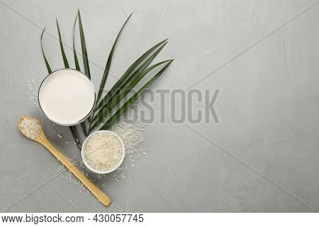 Delicious Rice Milk And Grains On Light Grey Table, Flat Lay. Space For Text