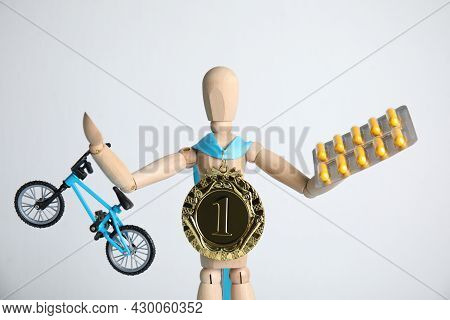 Sportsman Model With Medal, Bike And Pills On White Background. Using Doping In Cycling Sport Concep