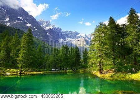 View of the lake Lago Blu near Breuil-Cervinia, Val D'Aosta,Italy. Beautiful mountain landscape in sunny day.