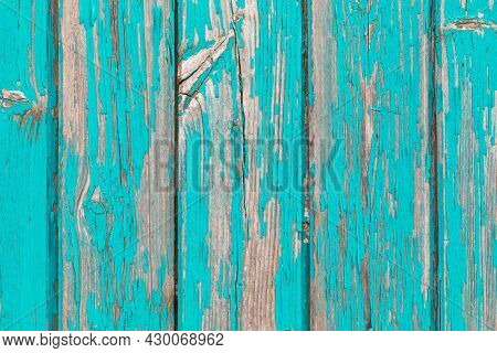 Turquoise weathered painted wood closeup abstract background