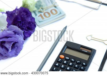 Clipboard With Blank Paper, Calculator, Paper Money And Purple Flowers Isolated On White Background.