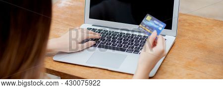 Young Asian Woman Using Laptop Computer Display Blank Screen Shopping Online With Credit Card On Tab
