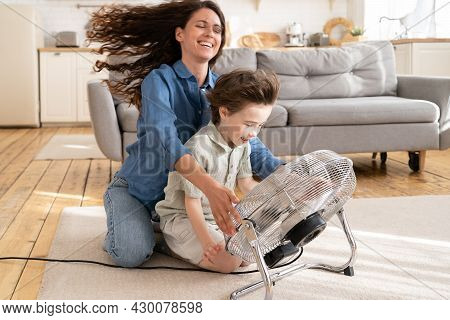 Loving Mom Relax And Having Fun With Child At Home: Carefree Young Woman Mother Sit Laughing Togethe