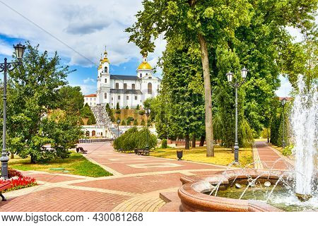 Travel Destinations. Holy Assumption Cathedral On The Assumption Hill In City Of Vitebsk With Founta