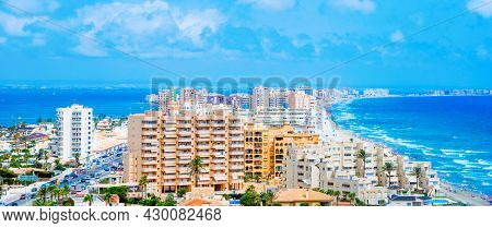 a view over La Manga del Mar Menor, in Murcia, Spain, with the Mar Menor lagoon on the left and the Mediterranean sea on the right, in a panoramic format to use as web banner or header