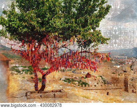 Sacred Tree Of Wishes And Dreams On The Territory Of The Old Ruined Fortress. Wish Tree With Colored