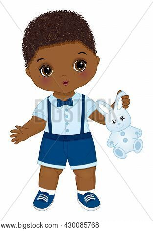Curly Black Baby Boy Wearing Blue Shirt With Bow And Navy Shorts . African American Baby Boy Holding