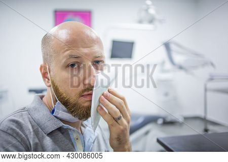 A Wisdom Tooth Extraction Surgery In Progress In A Dental Hospital. Dental Check Up.