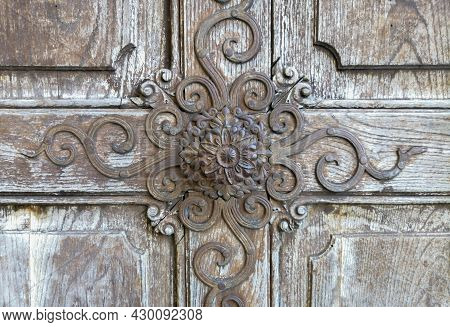 Detail Of A Beautiful Old Wooden Door Of Church Maria Strassengel, A 14Th Century Gothic Pilgrimage