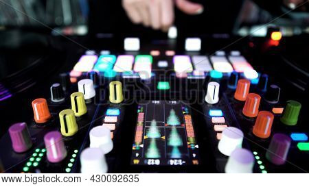 Deejay Playing Electronic Music On Turntable With Colorful Buttons, Time Lapse Effect. Art. Dj Touch