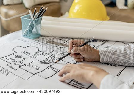 Architects Write On The Blueprints Of The Designed Houses, Designing The Buildings According To The