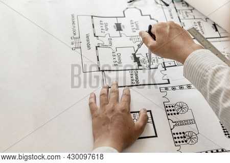 Architects Use Compasses To Write On The Blueprints Of The Houses, Designing The Buildings According
