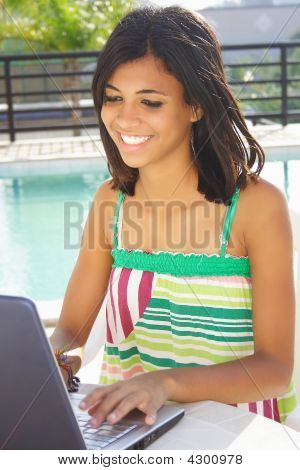 Girl Having Fun With Notebook