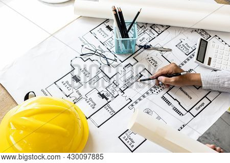 The Architect Wrote On The Blueprints To Modify The Design After Discussing With The Client, Designi