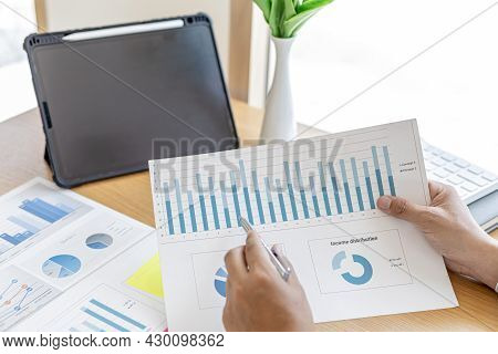 The Sales Manager Is Checking The Monthly Employee Sales Data For Accuracy Before Paying The Commiss