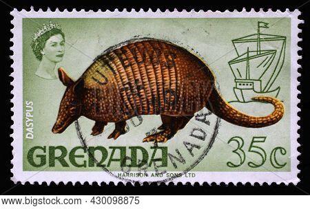 ZAGREB, CROATIA - SEPTEMBER 18, 2014: Stamp printed in Grenada shows Nine-banded Armadillo (Dasypus novemcinctus), Series Flora and Fauna Definitives 1968-1971, circa 1969