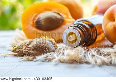 Apricot Kernel Oil In A Bottle. Selective Focus.
