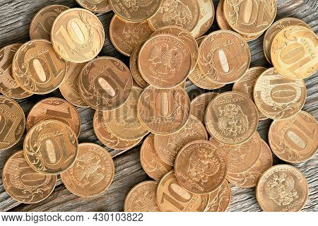 Coins With A Face Value Of 10 Rubles On A Wooden Table, Russian Rubles Close Up Background