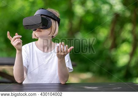 Smiling Woman Interacting With Virtual Reality. Reading Book In Virtual Reality Concept.
