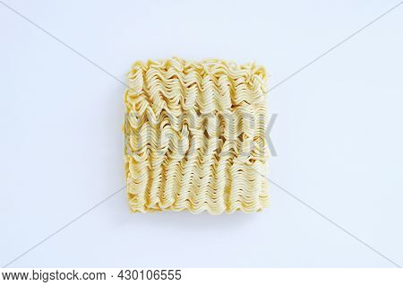 Briquette Of Dry Asian Instant Noodles On A White Plate. View From Above.