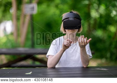 Smiling Woman Interacting With Virtual Reality. Payting In Virtual Reality Concept.