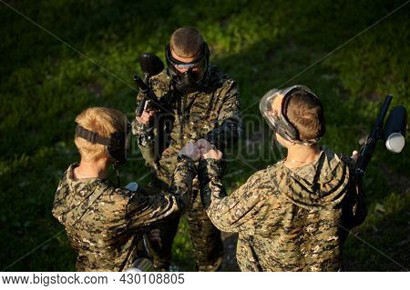 Team playing paintball, battle in the forest
