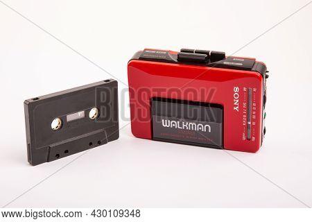 Huettenberg, Germany - 2021-04-07: Beautiful Red Vintage Sony Walkman Wm-24 With Black Audio Cassett