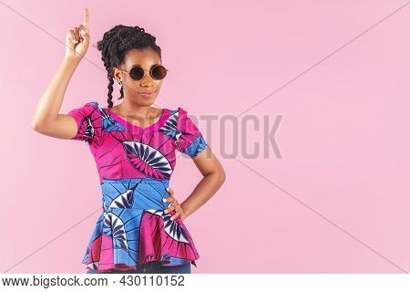 Afro American Woman Impatiently Pointing Upwards With Her Hand