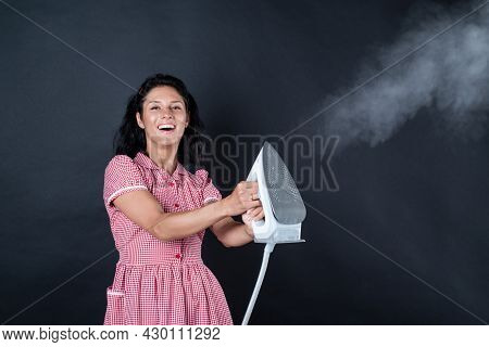 Nice Working Day. Pinup Girl Use Steaming Iron. Home Appliance. Housekeeper Woman Ironing. Happy And