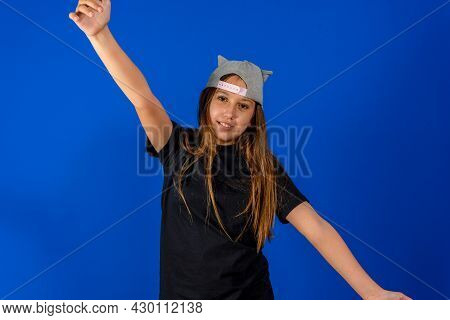 Adorable Little Girl Wearing Cap With Pineapple Pattern Extending Her Arms With Smile Going To Embra