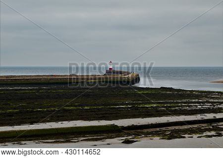 A View Of The Harbour Wall In The Northumberland Town Of Berwick Upon Tweed