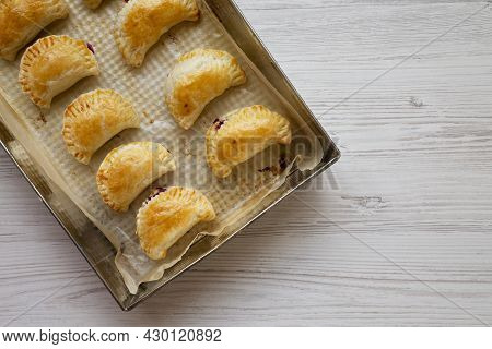 Homemade Cherry Hand Pies In A Baking Pan, Top View. Flat Lay, Overhead, From Above. Space For Text.
