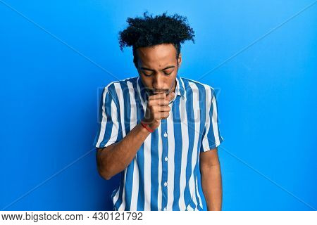 Young african american man with beard wearing casual striped shirt feeling unwell and coughing as symptom for cold or bronchitis. health care concept.