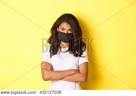 Concept Of Covid-19, Social Distancing And Lifestyle. Angry And Offended African-american Girl, Wear