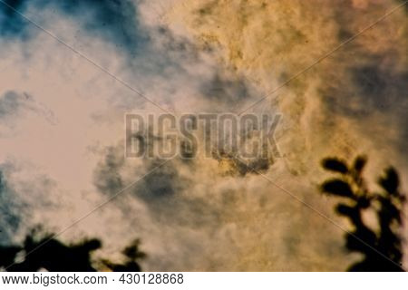 Sunlight Reflecting Along Cloud Bottoms For A Pastel Color And Soft Look Over Canyon, Texas In The P