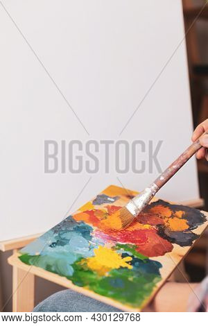 Male artist working on painting. Man artist painter and palettte in creative studio as art concept